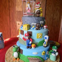 "Super Mario Bros Bottom layer is a 12"" vanilla with Vanilla Buttercream. Middle layer is a 10 "" with Red Velvet and Cream Chees filling. Top lyaer..."