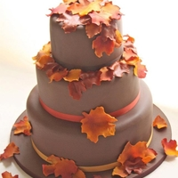 Autumn   Cakes covered in brown fondant with edible leaves painted with edible dust