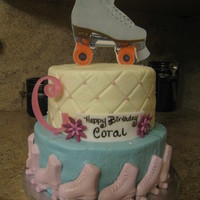 Roller Skate Cake Icing plaque roller skate on top, chocolate roller skates on the bottom tier. Thanks for looking!