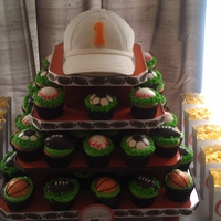 Sports Themed 1St Birthday Sports cupcake tower with baseball hat cake for my son's 1st birthday! Thanks for looking
