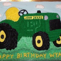 John Deere Tractor Birthday Cake Thanks to djjarrett88 for the idea for this cake! This is a strawberry cake with buttercream icing. The tractor was made with the Wilton...