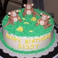 Monkey Birthday Cake This was for a friend of my aunts who likes monkeys. :) Its red velvet with cream cheese frosting. The monkeys and bananas are gumpaste.