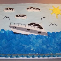 Speed Boat Birthday Cake This cake is french vanilla with buttercream icing. The speedboat is a FBCT.