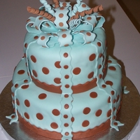 Polka Dot Baby Shower Cake The mommy was very specific on what she wanted. A 2 tier cake, blue with brown polka dots with a bow on top and ribbon coming down the...
