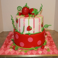 Strawberry Shortcake Inspired Strawberry Shortcake inspired cake for two sisters celebrating together! The large strawberries on top are cake - one for each sister! Cake...