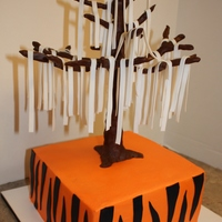 "Toomer's Corner 8"" square cake iced in orange buttercream (sugarshack) with navy fondant tiger stripes with oak tree form made from skewer, floral..."