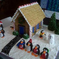 "First ""gingerbread"" House Made with graham crackers connected together by peanut butter confectionery coating. Nearly everything else made of fondant. Penguins..."