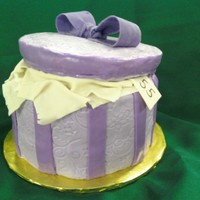Purple Hat Box I made this birthday cake for a lady I work with who loves purple and wanted a hat box cake. 3 layers of vanilla cake with butterscotch...