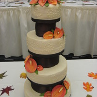 Fall Wedding Cake buttercream icing, ivory icing, chocolate brown ribbon and dividers, burnt orange calla lilies