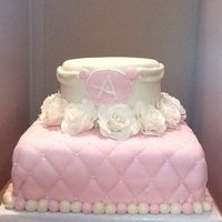 Princess Birthday White cake covered in fondant. Gum paste roses. Fondant accents.