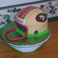 49Er's Helmet This was a migraine!! My original facemask broke when trying to apply it to the cake, so I had to make an emergency mask...thank heavens...