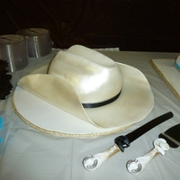 Cowboy Hat Groom's Cake Chocolate Cake, Chocolate Mousse filling. Covered in Fondant and airbrushed.