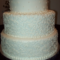 White Tiered Cake All carrot cake with cream cheese frosting and fondant.