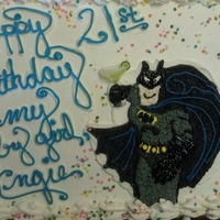 Batman   Sheet cake frosted with pastry pride. Batman is made with buttercream frosting and I used a pick for the margarita