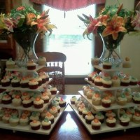 Cupcake Wedding 200 cupcakes flavored 4 different flavors: white, chocolate, funfetti, and red velvet. The red velvet were iced with cream cheese and the...