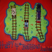 Thomas The Train Cupcake Cake 1/2 chocolate, 1/2 white cupcakes, all decorated in buttercream :)