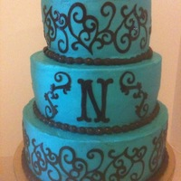 Teal Wedding Cake Three tier (12-10-8) iced in buttercream with chocolate fondant Cricut design,