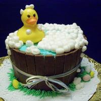 Easter Ducky I made this cake for our bake sale raffle. 6 in french vanilla cake frosted with vanilla BC frosting tinted blue and the sides are kit kat...