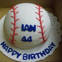 Ian's Birthday Baseball I made this cake for a friends husbands birthday. He was a baseball player in college. Chocolate cake with BC and covered with MMF and MMF...