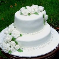 White Cake With Roses fondant roses on fondant cake with flower border.