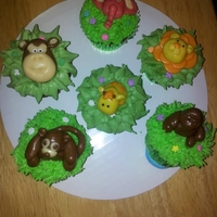 Jungle Animal Cupcakes Animals are made of tootsie rolls. Worked well on flat faces but the giraffe kept falling over.