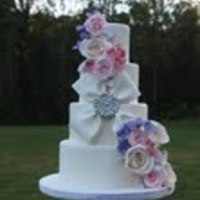 Flowers And Blingy Bow Gumpaste floral cascade with edible bow