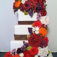 Fall Flowers Fall wedding cake with flowers.
