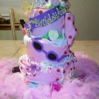 Fancy Nancy Cake fancy nancy cake with some fondant decorations and some nonedible decorations.