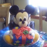Mickey Mouse mickey mouse cake. made with rice crispies and covered in fondant.