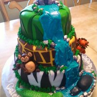 Jungle Theme Cake In the jungle theme cake. characters made out of fondant.