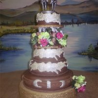 Western Theme Wedding Cake Everything is made out of gumpaste or fondant except the flowers and rope.
