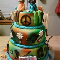 Hippie Cake Theme hippie cake theme. characters are made out of fondant.