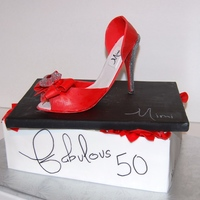 50Th Shoe Cake is vanilla and chocolate with raspberry filling. Gumpaste shoe with edible jewel.