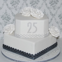 25Th Anniversary Cake Silver Highlighted Art Deco Border And Silver Dusted Briar Roses Chocolate Cake With Chocolate Hazelnut Buttercream 25th Anniversary CakeSilver highlighted art deco border and silver dusted briar roses. Chocolate cake with chocolate hazelnut buttercream