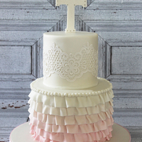 Ruffles & Lace First Communion My client asked for just a touch of pink on this First Communion Cake, so I decided to go with minimal ombre ruffles. Lace on top tier is...