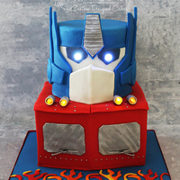 Transformer Cake A take on Optimus Prime. Cake is covered in fondant and I used balloon lights for the eyes and headlights. TFL