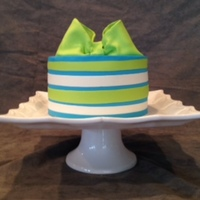 Jon's Baptism Cake Modeling chocolate bow and trim.