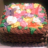 Basket Cake With Roses & Butterflies Square basket cake with butter cream frosting. Multicolored butter cream roses and white chocolate butterflies. Thanks for looking!