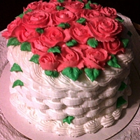 Basket Cake With Pink Roses White Basket Cake filled with Pink Roses. Vanilla Cake frosted in Vanilla Butter Cream.Thanks for looking!