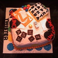 Game Cake Children's birthday cake with assorted games theme. Twister, marbles, UNO, Dice, Scrabble tiles, Boggle.
