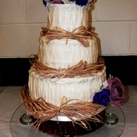 Rustic Wedding Cake With Raffia Top Amp Bottom Tiers Are Vanilla With Vanilla Butter Cream Filling Middle Tier Is Red Velvet Filled With Rustic Wedding cake with Raffia. Top & bottom tiers are Vanilla with Vanilla Butter Cream Filling. Middle tier is Red Velvet filled...