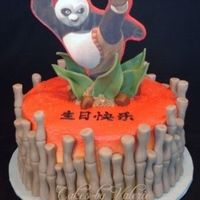 "Kung Fu Panda This is an 8"" round cake ice in buttercream, then sprayed with yellow and red color mist. The bamboo, leaves, and rocks are made from..."