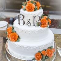 "Orange Roses - Fall Wedding Cake 14"", 10"", 6"" round cakes covered in fondant. Orange roses and leaves made from gumpaste. Scrollwork done in royal icing with..."