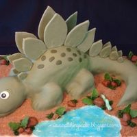 Prehistoric This is a chocolate cake covered in marshmallow fondant and marshmallow fondant accents. The dirt was made with brown sugar and the water...