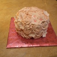 Blush Roses   WASC cake with fresh strawberry filling, buttercream roses and gumpaste petunisa.