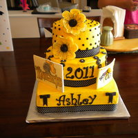 Yellow And Black Grad Marble cake, buttercream icing and gumpaste accents.