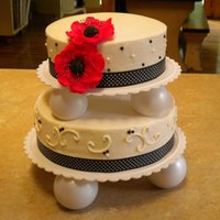 Red White & Black   Graduation cake done in the school colors. Buttercream with sugar pearls and gumpaste flowers.