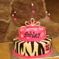 Hot Pink Zebra   Bottom tier is chocolate fudge cake, top tier is strawberry banana. Filled and covered in buttercream with fondant accents.