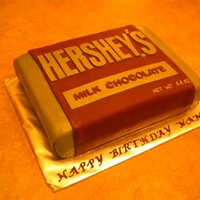 Hershey Bar Chocolate fudge cake with cheesecake mousse filling and chocloate buttercream covered in fondant.