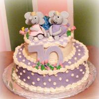 And Elephant Cake! This is a cake i made for a woman who was turning 70 that loves elephants and purple! The elephants are gumpaste, and even though you cant...